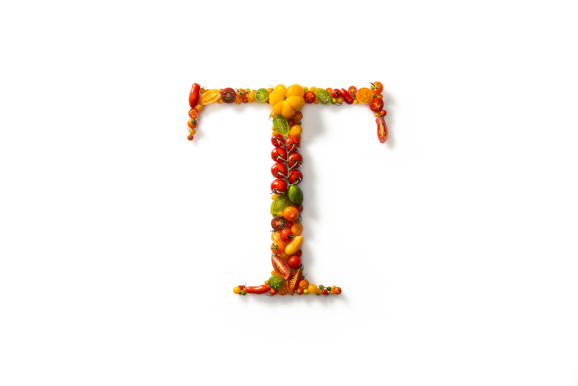 Tonelli T Logo with Tomatoes
